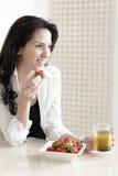 Woman enjoying breakfast Royalty Free Stock Image