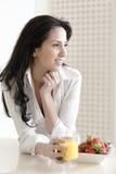 Woman enjoying breakfast Stock Image