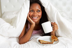 Woman Enjoying Breakfast In Bed Royalty Free Stock Photography
