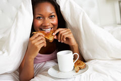 Woman Enjoying Breakfast In Bed Stock Photography