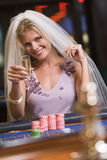 Woman enjoying bridal shower at casino. Drinking champagne Stock Image