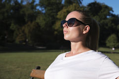 Woman enjoying the bright sun Royalty Free Stock Photos