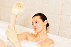 Woman enjoying bubble bath Stock Photo