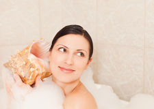 Woman enjoying bubble bath Royalty Free Stock Photos