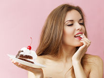 Woman enjoying the cake Royalty Free Stock Photo