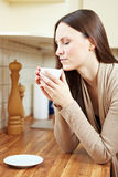 Woman enjoying coffee Royalty Free Stock Photos