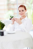 Woman enjoying coffee Stock Photos