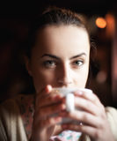 Woman enjoying coffee and dreaming Royalty Free Stock Images