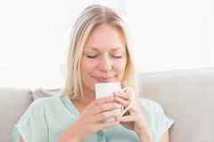Woman enjoying coffee at home Stock Photos