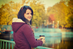 Woman enjoying coffee in park Stock Photo