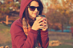 Woman enjoying coffee in park Stock Images