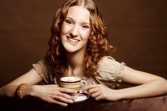 Woman enjoying coffee time Royalty Free Stock Image
