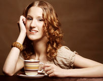 Woman enjoying coffee time Royalty Free Stock Images