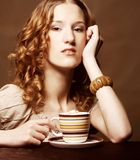 Woman enjoying coffee time Stock Image