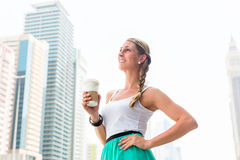 Woman enjoying coffee to go in metropolitan city Stock Photo