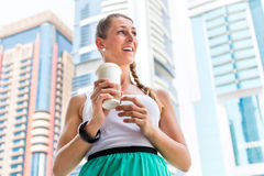 Woman enjoying coffee to go in metropolitan city Royalty Free Stock Photography