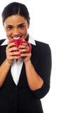 Woman enjoying coffee during work break Stock Photos