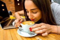 Woman enjoying coffee Stock Images