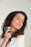 Woman enjoying a cold drink Royalty Free Stock Photography