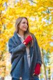 Woman enjoying the colorful yellow fall foliage Stock Image