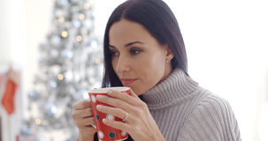 Woman enjoying a cup of Christmas coffee Stock Image
