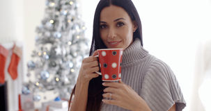 Woman enjoying a cup of Christmas coffee Stock Photos