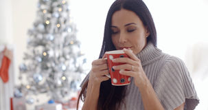 Woman enjoying a cup of Christmas coffee Stock Photography
