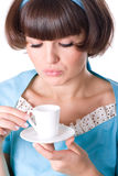 Woman enjoying a cup of coffee Royalty Free Stock Image