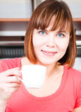 Woman enjoying a cup of coffee Royalty Free Stock Photography