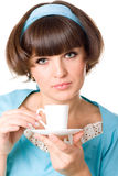 Woman enjoying a cup of coffee Stock Images