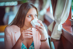 Woman Enjoying A Cup Of Coffee in Cafe Royalty Free Stock Images
