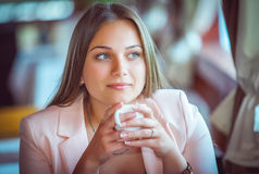 Woman Enjoying A Cup Of Coffee in Cafe Stock Photo