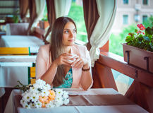 Woman Enjoying A Cup Of Coffee in Cafe Royalty Free Stock Image