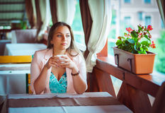 Woman Enjoying A Cup Of Coffee in Cafe Royalty Free Stock Photography
