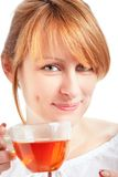Woman enjoying a cup of tea Stock Images