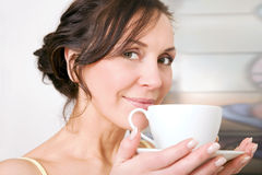 Woman enjoying a cup of tea Stock Photo