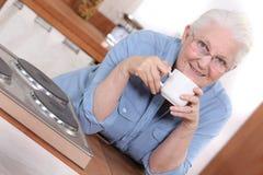 Woman enjoying a cup of tea Stock Photo