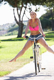 Woman Enjoying Cycle Ride Stock Photo