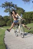 Woman Enjoying Cycle Ride Stock Photo