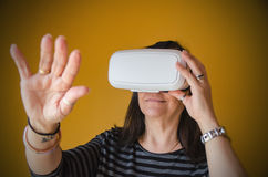 A woman enjoying a 3d experience with a vr headset Royalty Free Stock Photography