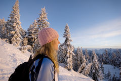 Woman enjoying dawn in the mountains Stock Images