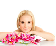 Woman enjoying dayspa. Portrait of pretty woman enjoying dayspa, picture of young beautiful lady with pink orchid flower  on white background, zen balance Stock Images