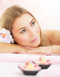 Woman enjoying dayspa. Picture of attractive woman enjoying dayspa, nice blond girl laying down on massage table in luxury spa salon, aroma therapy, beauty Stock Photo