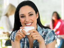 Woman Enjoying Drink In Cafe Stock Image