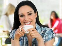 Woman Enjoying Drink In Cafe Stock Image
