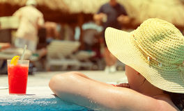 Woman enjoying drink at swimming pool Royalty Free Stock Images