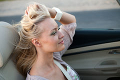 Woman enjoying driving cabriolet Royalty Free Stock Photo