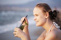 Woman enjoying an evening cocktail Stock Image