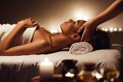 Woman enjoying face massage and aroma therapy in spa