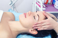 Woman enjoying facial massage Royalty Free Stock Image